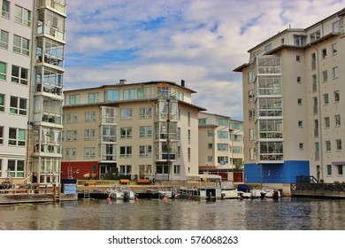 Modern architecture in Karlstad, Sweden, Europe: Residential buildings with conservatories for each apartment. On the banks of the river Klaralven, motor boats right on the doorstep.