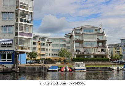 Modern architecture in Karlstad, Sweden, Europe: Residential buildings with glazed loggias for each apartment. On the banks of the river Klaralven, motor boats right on the doorstep.