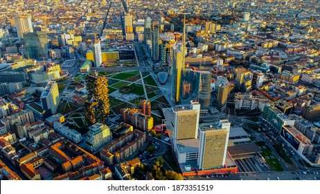 Modern architecture. Roofs of houses. Aerial view of the city at sunrise or sunset flies. Tower Unicredit. skyscrapers. Vertical forest. Garibaldi railway station. Milan. Italy, 12.12.2020: