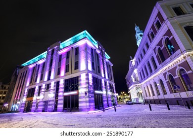 Modern architecture and Town hall in Old Riga, Latvia at winter night
