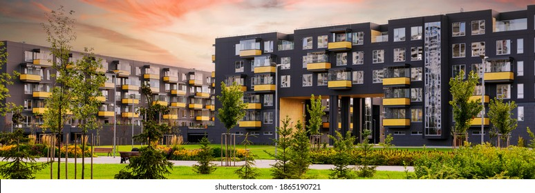 modern architecture of urban residential apartment buildings with park at sunset
