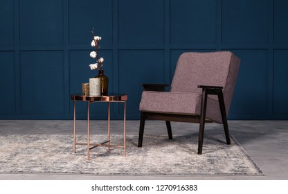 Modern armchair with copper coffee table and table accessories