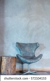 Modern armchair over rustic wall in Living room / interior redecoration & renovation conceptual