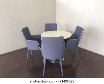 Modern armchairs and wooden table decor at home