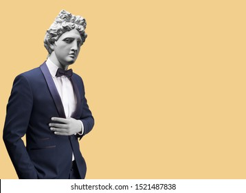Modern art collage. Concept portrait of handsome stylish man in elegant blue suit .Gypsum head of of Apollo. Man in suit.
