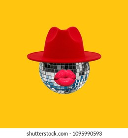 Modern Art collage.Disco ball face with red lips wearing red hat.