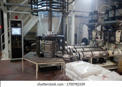 Modern automated production line in factory. Plastic foil manufacturing process.