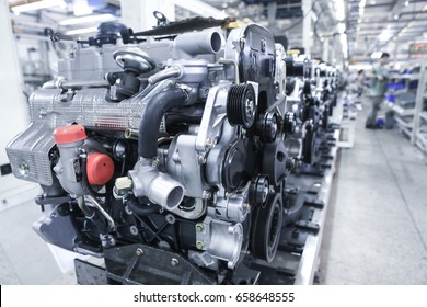 Modern automatic automobile manufacturing workshop. The new car engines are waiting to be installed. Industrial scenery background.