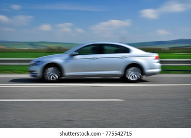 Modern automobile in speed car on road