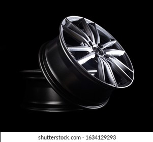 Modern automotive alloy wheel made of aluminum on a black background, industry. Designer fashion wheels for car
