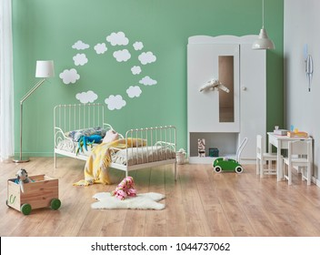 Modern baby room green wall and white bedroom style white cabinet and toys style