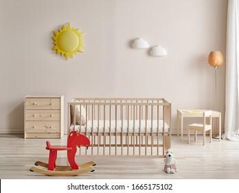 Modern baby room,  wooden crib and rocking horse interior decor.