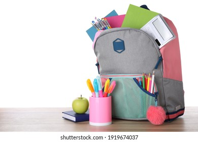 Modern backpack with stationery on white background