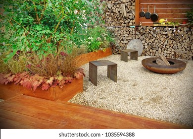 Modern Backyard Patio With Summer Kitchen And Iron Fireplace, Back Yard Design Concept. Decorative Patio Or Terrace For Family Rest