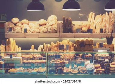 Modern bakery with assortment of bread, cakes and buns