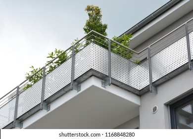 Modern Balcony with Hand Rails of high-grade Steel  at a Residential Building