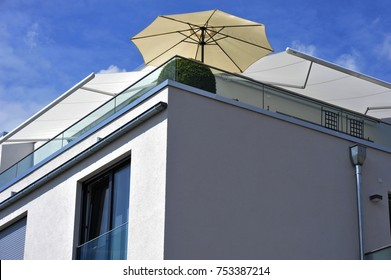 Modern Balcony with Hand Rails of high-grade Steel combined with Electric Awnings and sunshade at a Penthouse-Apartment