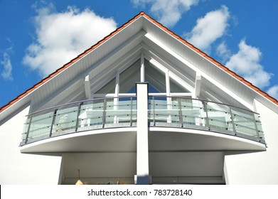 Modern Balcony with Hand Rails of high-grade Steel in Front of a modern Building