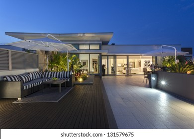 Modern balcony at sunset in luxury penthouse