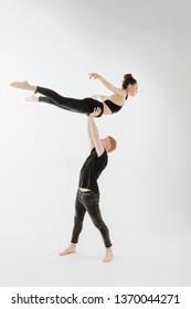 Modern Ballet Dance Couple High Level Lift Pose. Man in Stand, Hold Young Woman Dancer with Two Hand. Caucasian Brunette Skinny Girl Perfomer Flying Position Isolated on White Background