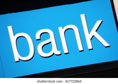 Modern bank sign above its building entrance