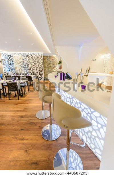 Modern bar counter with chairs and blurred background