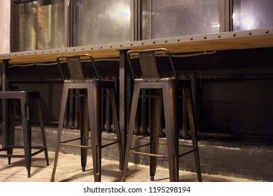 Modern bar with seats and windows in grunge style, empty interior