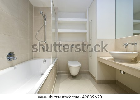 Modern Bathroom With Beige Tiles And Beige Marble