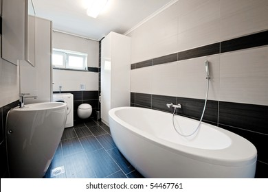 Modern bathroom with black tiles