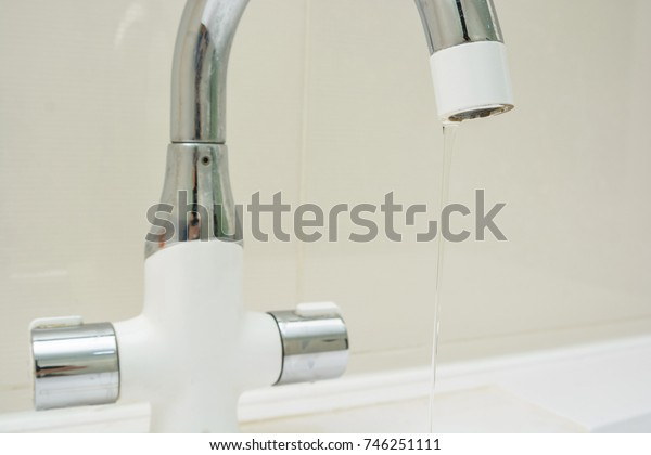 Modern bathroom with chrome tap