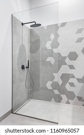 Modern bathroom in gray and white with walk in shower