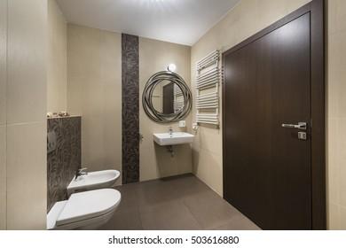 Modern bathroom interior design with classic ceramic fixtures