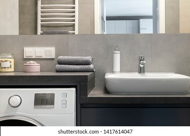 Modern bathroom interior design in gray and sand colors