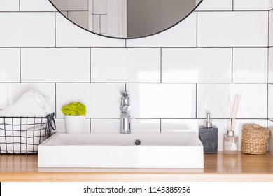Modern bathroom interior in details. White tile and sink.