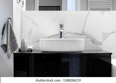 Modern bathroom with marble finishing in black and white style
