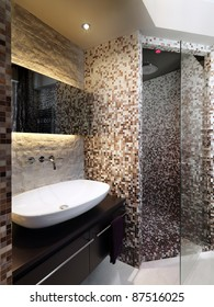 modern bathroom  with mosaic and masonry shower cubicle