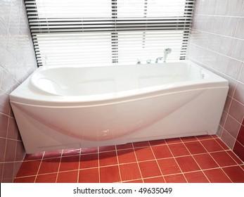 modern bathroom with porcelain bathtub
