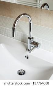 Modern bathroom, sink in white ceramic
