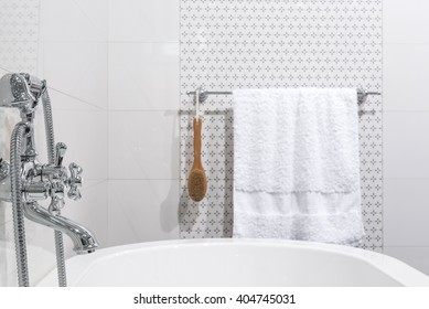 Modern bathroom with white bathtub and towels