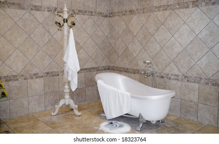 The modern bathroom with a white tub