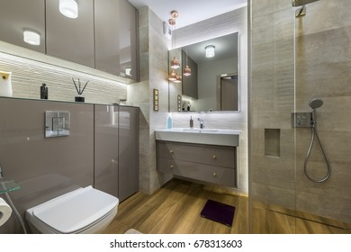 Modern bathroom with wooden floor in stylish apartment