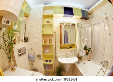 Modern Bathroom in yellow and blue vivid colors fisheye view