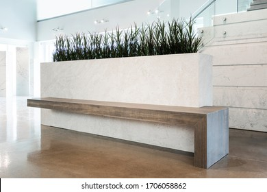 A modern beautiful custom planter bench made with stonelike and woodlike porcelain