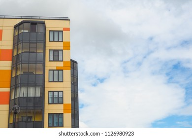 Modern beautiful new buildings. Colored wall on the background of blue sky.