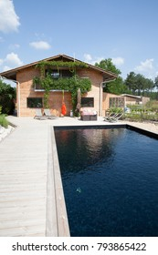 modern beautiful wooden house on a floor with a swimming pool