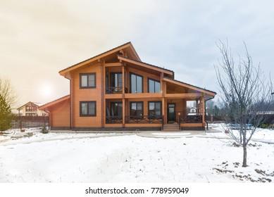 Modern beautiful wooden house - winter natural photo