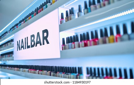 Modern beauty salon interior. Nail bar. Nail polishes of different colors on shelves.