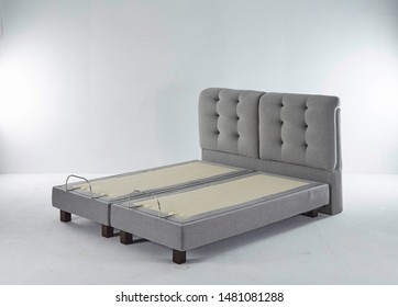 Modern bed design with adjustable bed. Luxurious bed gray color in a grey background