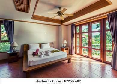 Modern bed room interior in Luxury villa. White colours, Decoration from towels