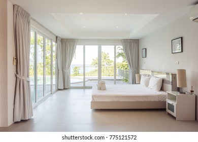 Modern bed room interior in Luxury villa. White colours, big window